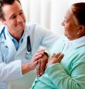 Senior woman being visited by a doctor by her bedside